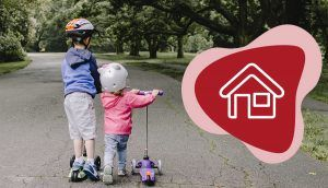"""An older boy and younger girl are riding on scooters down an outdoor path, with the red """"Live"""" icon in the bottom right"""