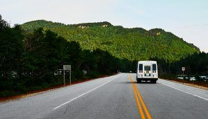 Highway through the White Mountains in New Hampshire with a camper van