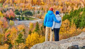 Couple hiking at Artist's Bluff in autumn - White Mountain National Forest, New Hampshire