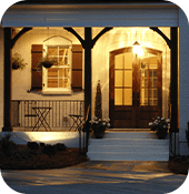 Front door of house with light on at night